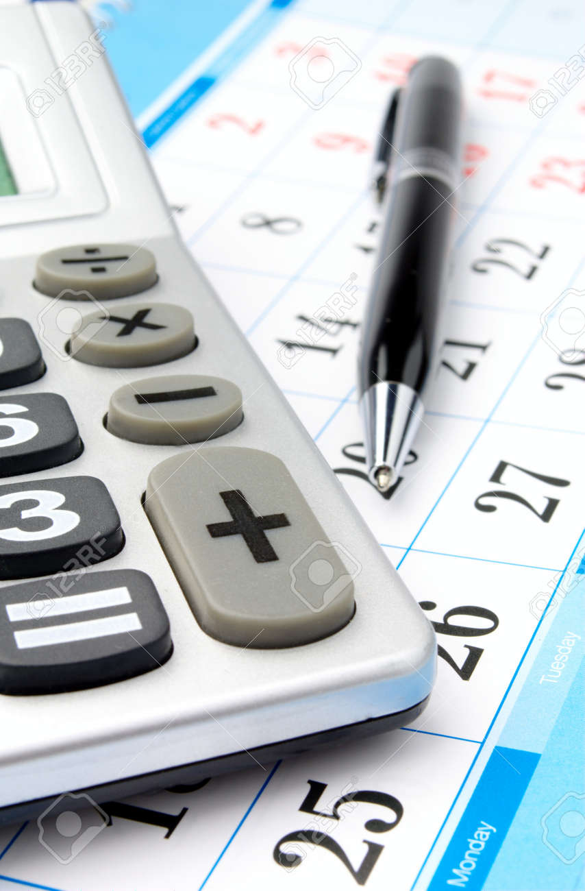 Calendar A Calculator And A Pen Close Up Stock Photo Picture And