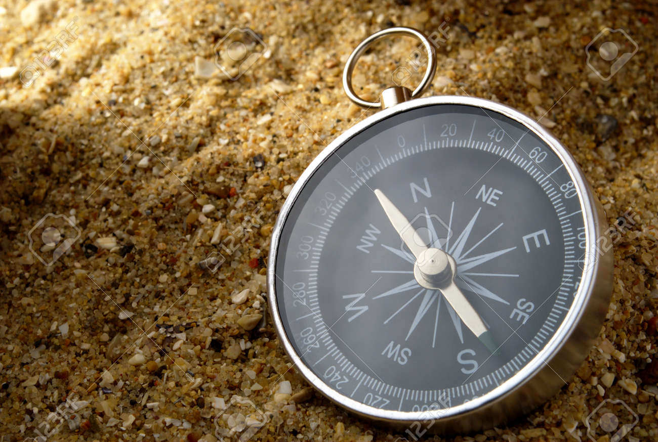 compass in the sand lit beacon of light Stock Photo - 11716000