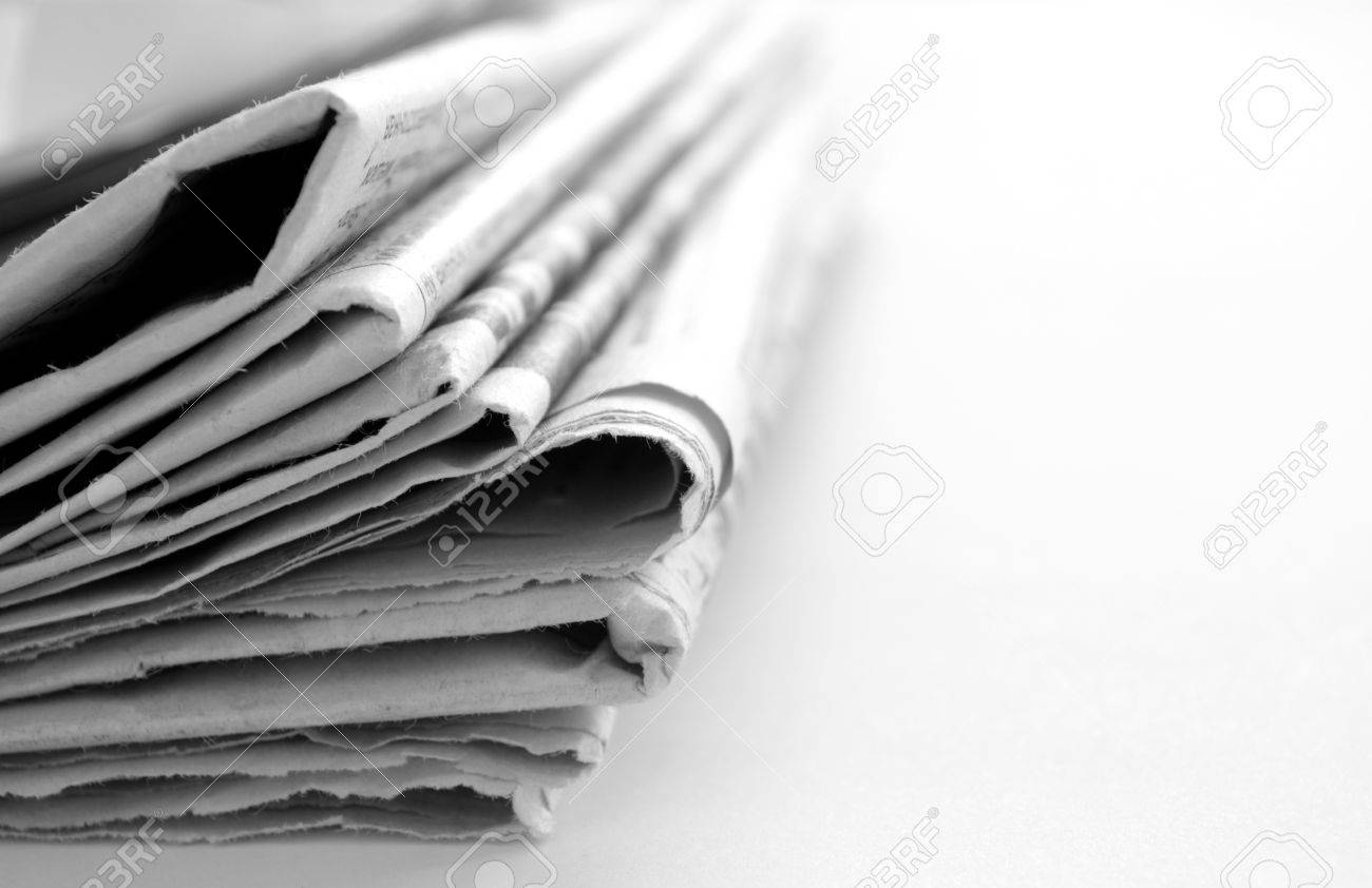 newspaper with news closeup on white background Stock Photo - 14866909