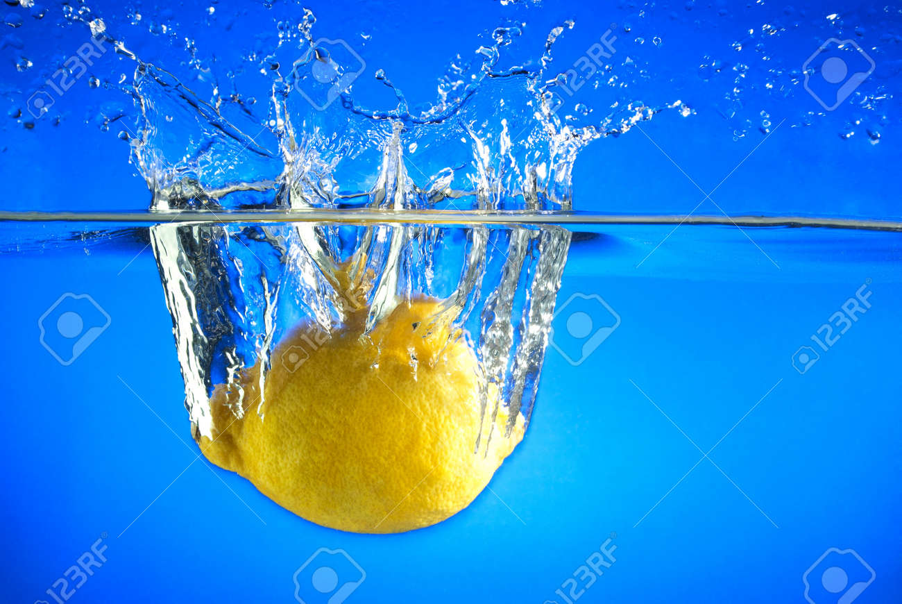 Lemon fell into the water, splashes and bubbles Stock Photo - 17163648