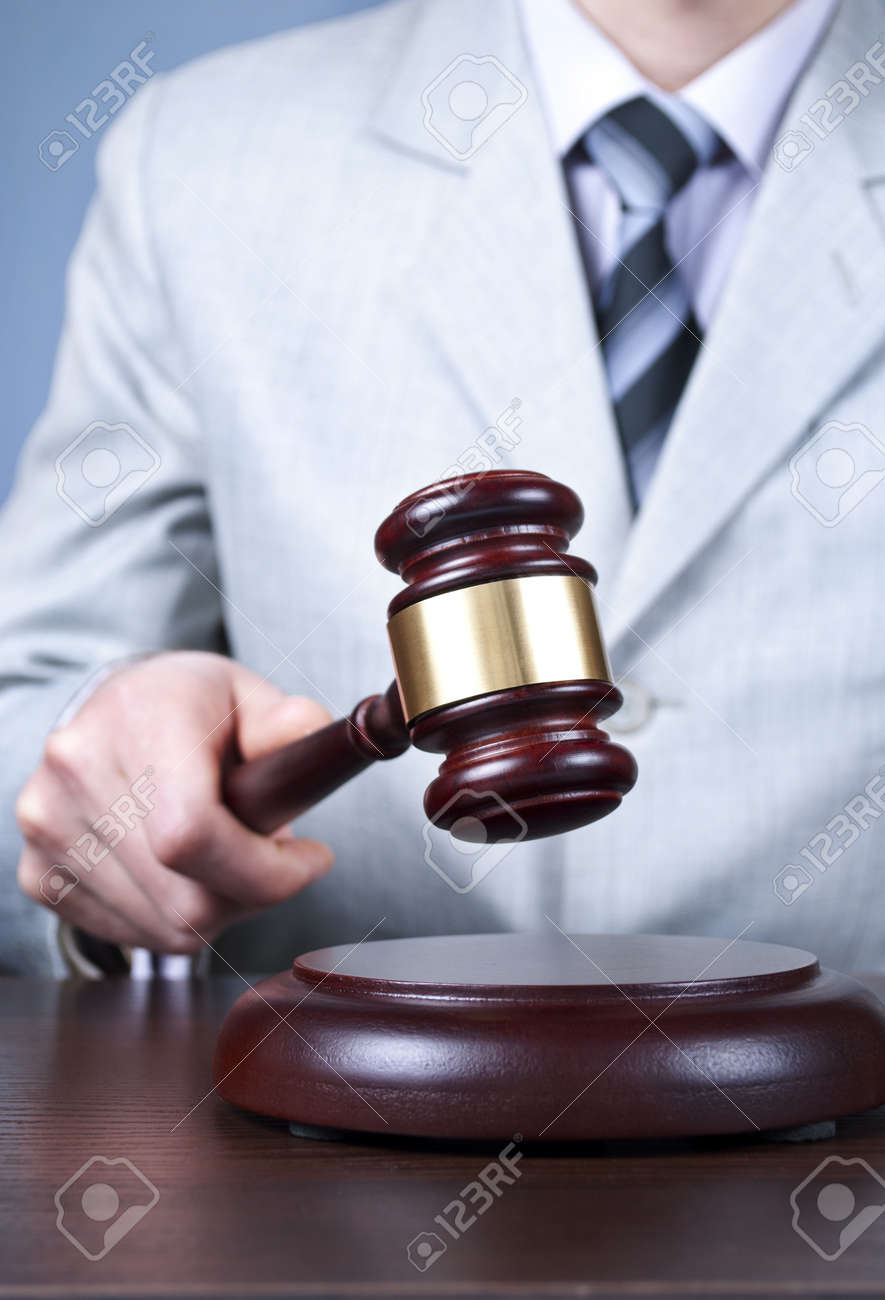 gavel in the hand of a man in a business suit Stock Photo - 17467119
