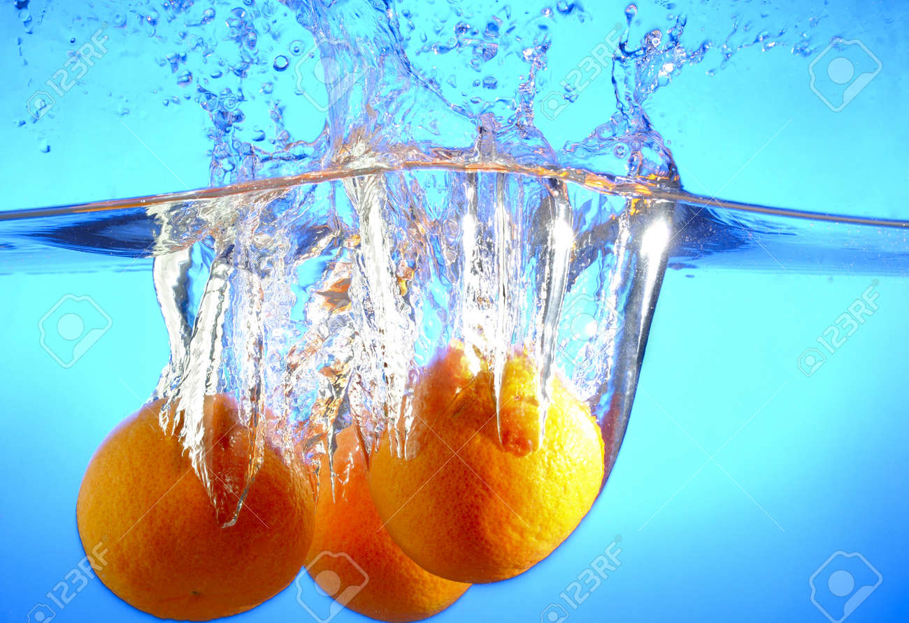 Orange falls into the water and making splashes Stock Photo - 17467106