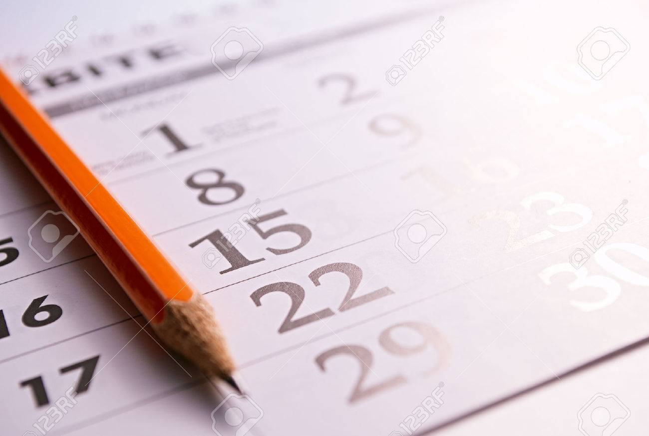 Close-up of a sharp pencil on the page of a calendar, in order to mark days with events - 30977274