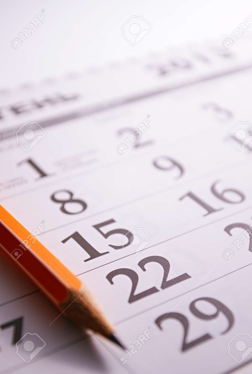 Close-up of a sharp pencil on the page of a calendar, in order to mark days with events - 30977206
