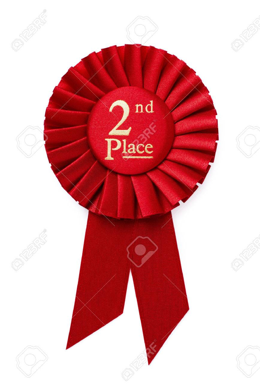 Red 2nd place ribbon rosette with gold central text in a pleated surround isolated on white - 32607540