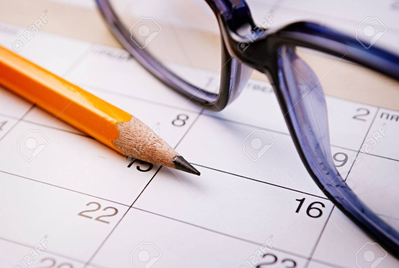 Calendar, pencil and glasses for planning important things and to set a date. - 32607546