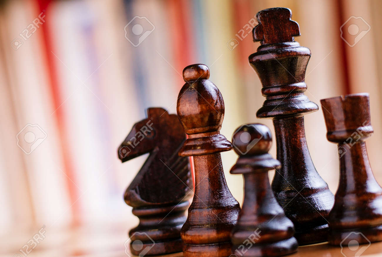 Close up Glossy Black Wooden Chess Pieces- King, Bishop, Knight, Rock and Pawn, Standing on Chess Board. - 34105468