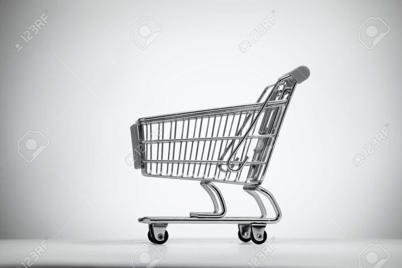 Empty shopping cart, isolated on light background. - 36510600