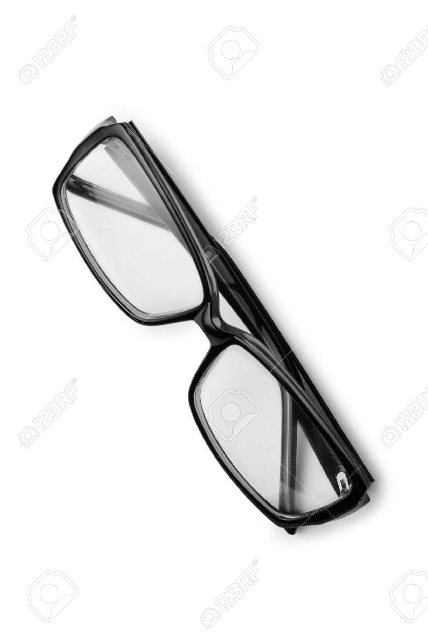 Pair of reading glasses or spectacles with modern dark frames folded up on a white background, view from above - 37251247