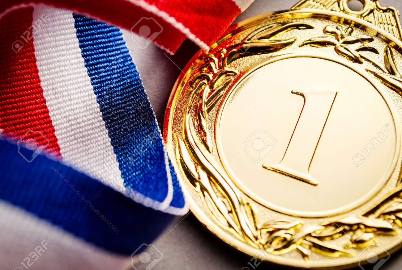 Gold medal in the foreground on three-colour ribbon - 41722523