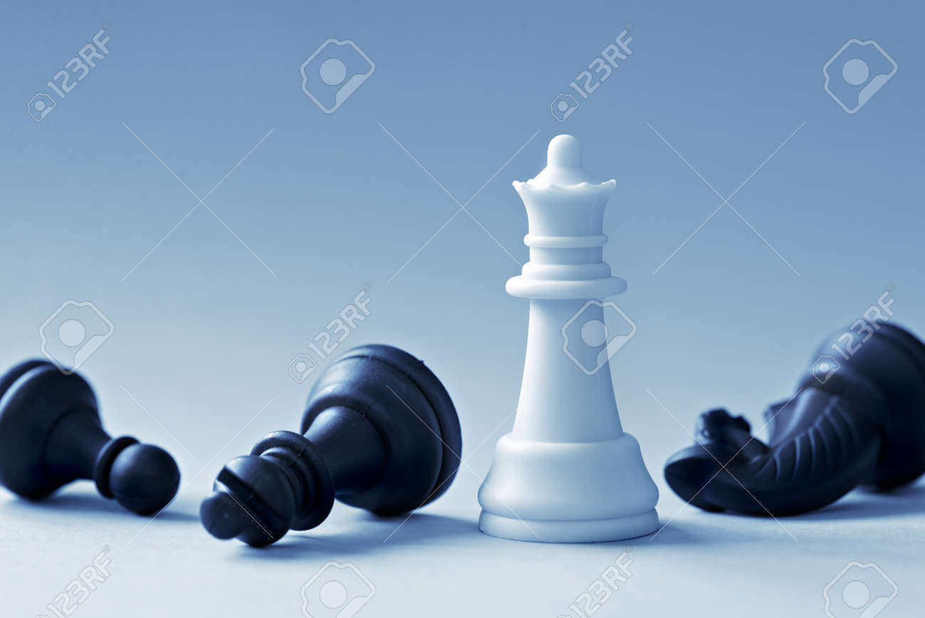 White Chess Queen and defeated black shapes on a light blue background - 63248922