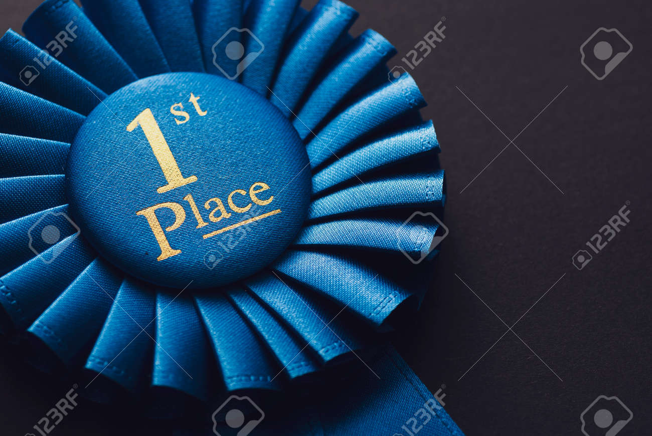 Champion 1st place blue rosette with gold text on black background - 128131116