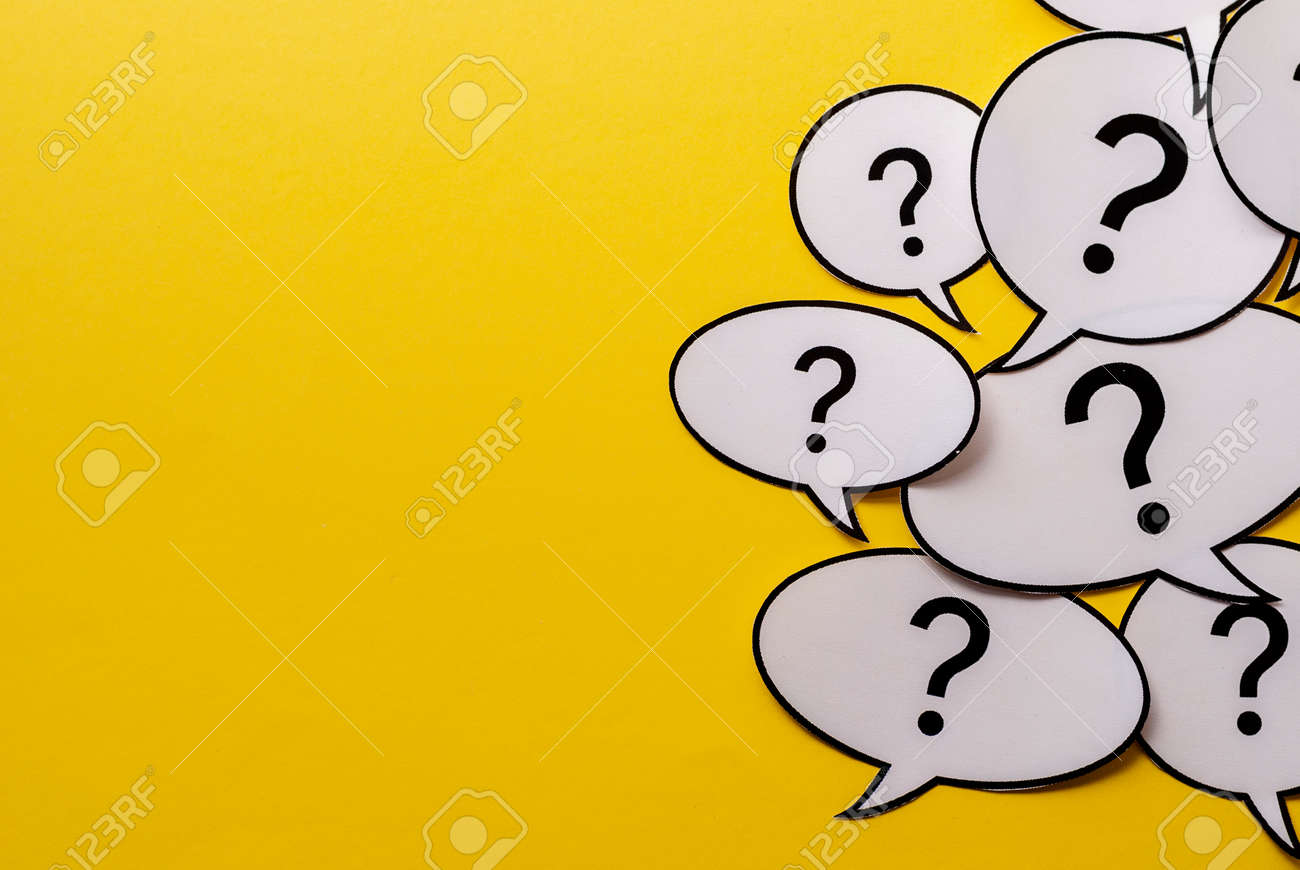 Multiple question marks in speech bubbles forming side border o a bright yellow background with copy space - 134956513