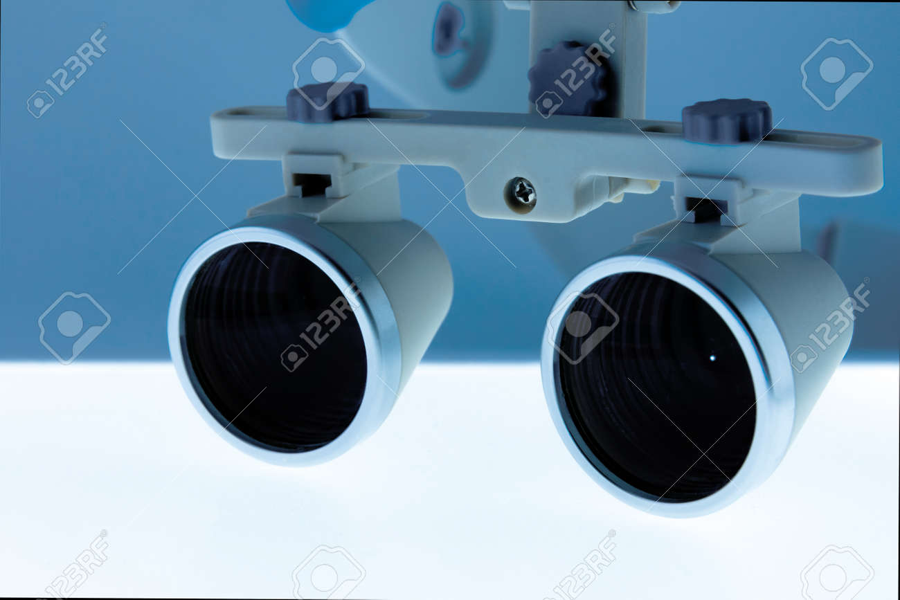 373d6ca29874 Magnifying binocular glasses close-up. Dental instruments in the clinic.  The concept of
