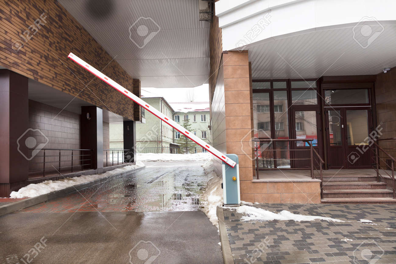 Automatic barrier gates to enter the courtyard of the building