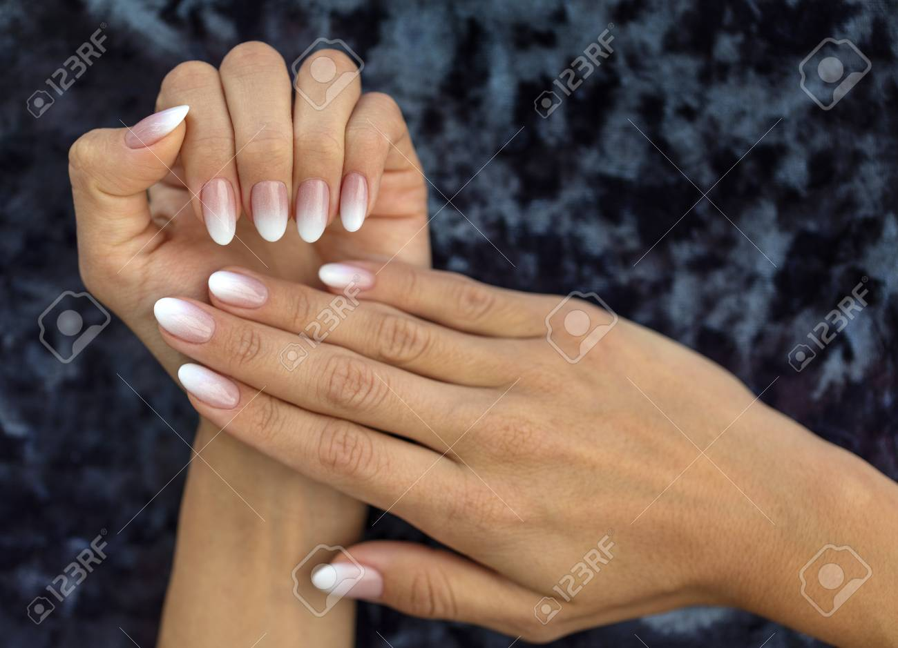 Beautiful woman's nails with beautiful french manicure ombre