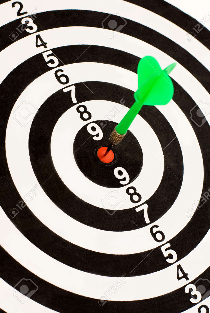 Green dart stuck in the center Stock Photo - 1746301