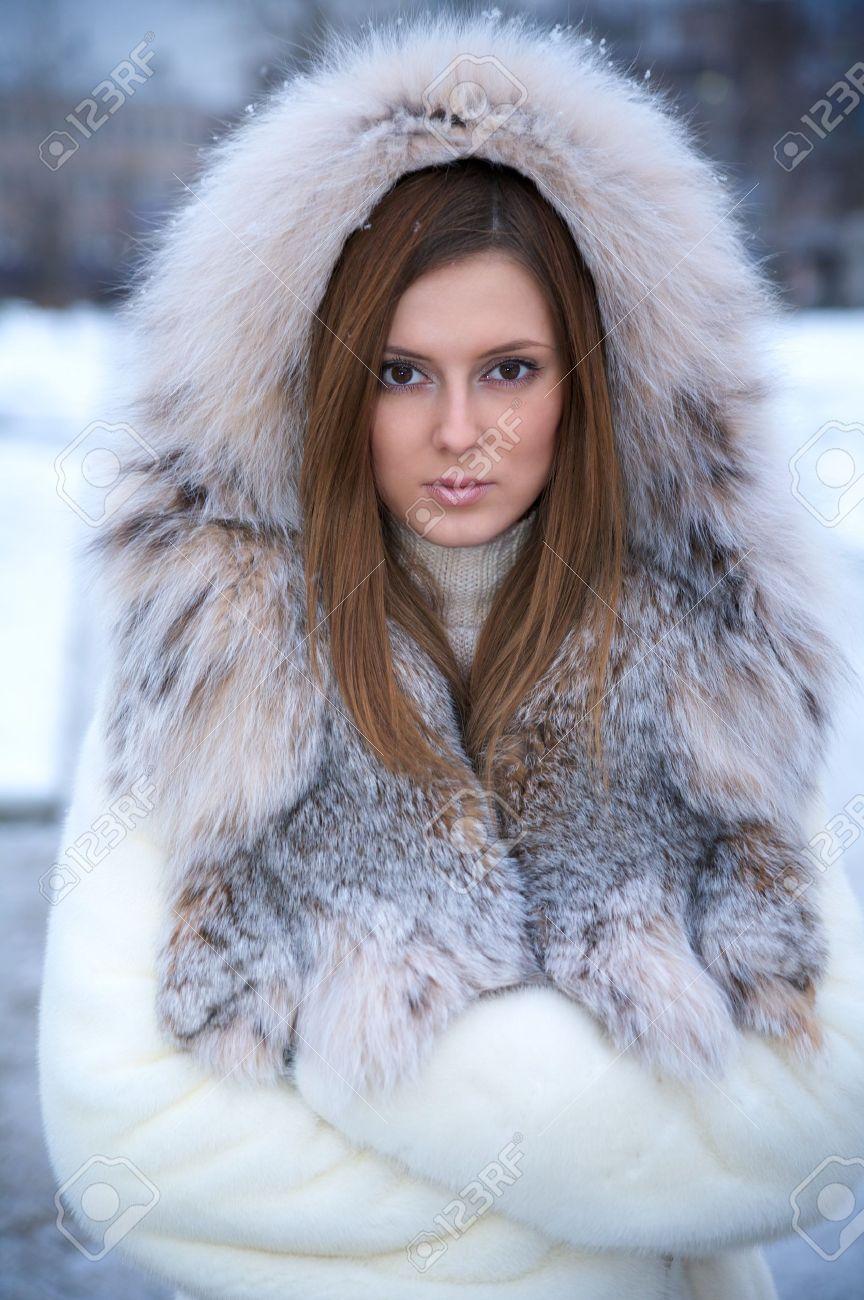 Beautiful Young Woman In Winter Fur Coat. Winter Portrait Stock