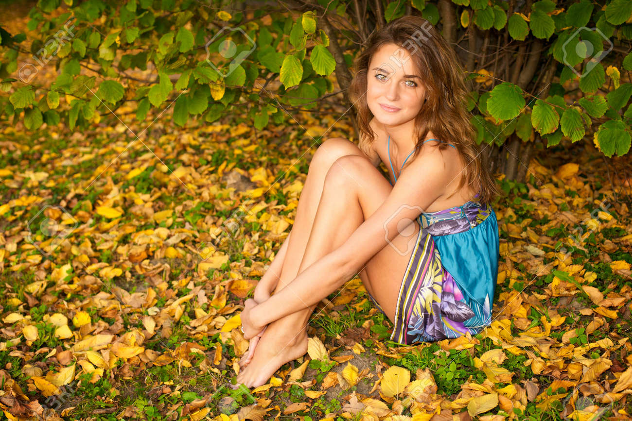 Young beautiful woman sitting in the autumn forest Stock Photo - 6368198