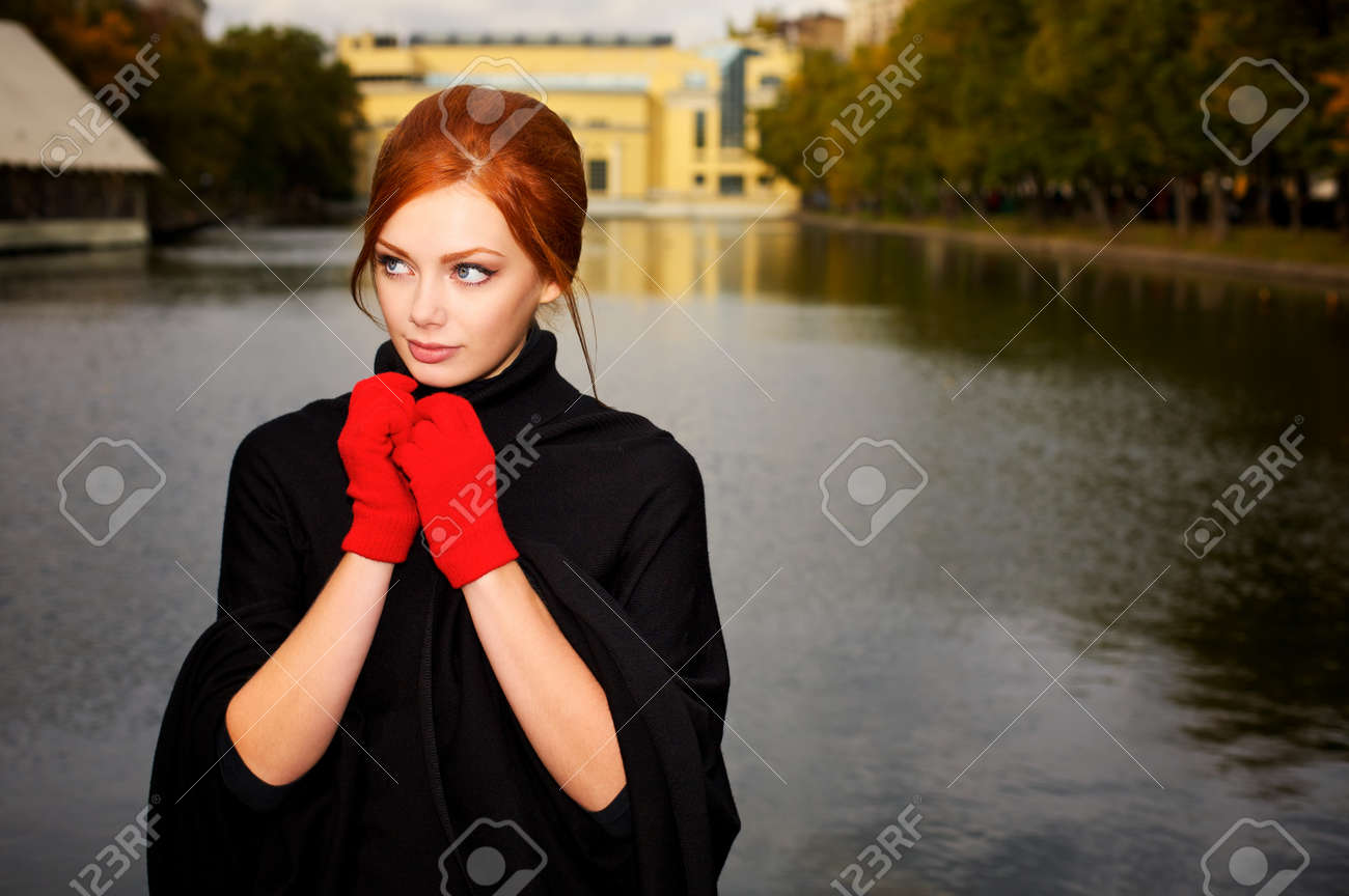 Portrait of a beautiful red-haired woman in red gloves Stock Photo - 6928958