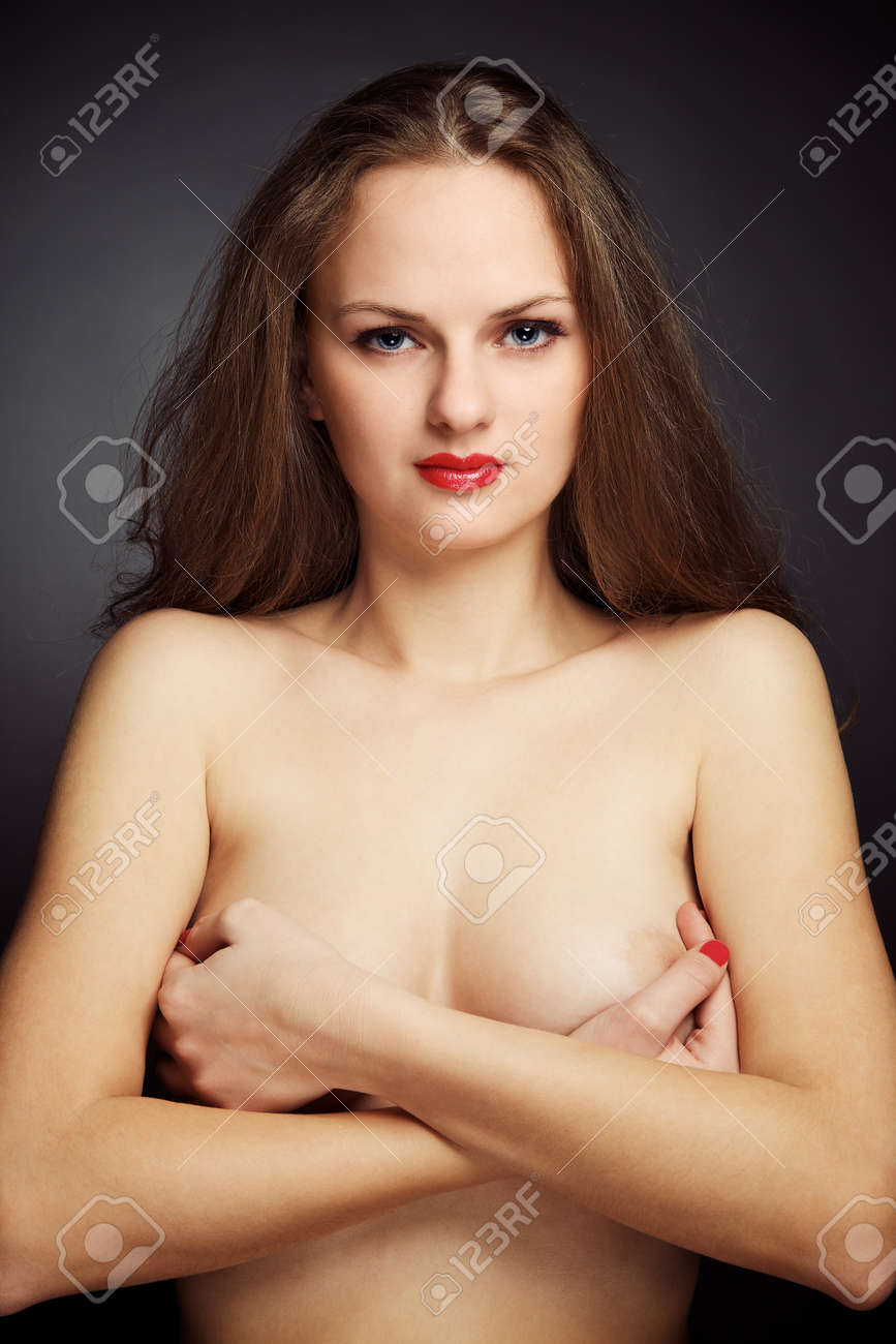 Portrait of naked young woman over dark, studio shot Stock Photo - 6943507
