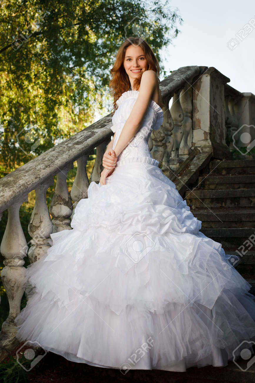 Bride posing on stairs of old abandoned house Stock Photo - 7172504