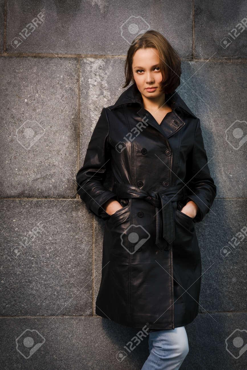 Beautiful young woman near stone wall Stock Photo - 17419869