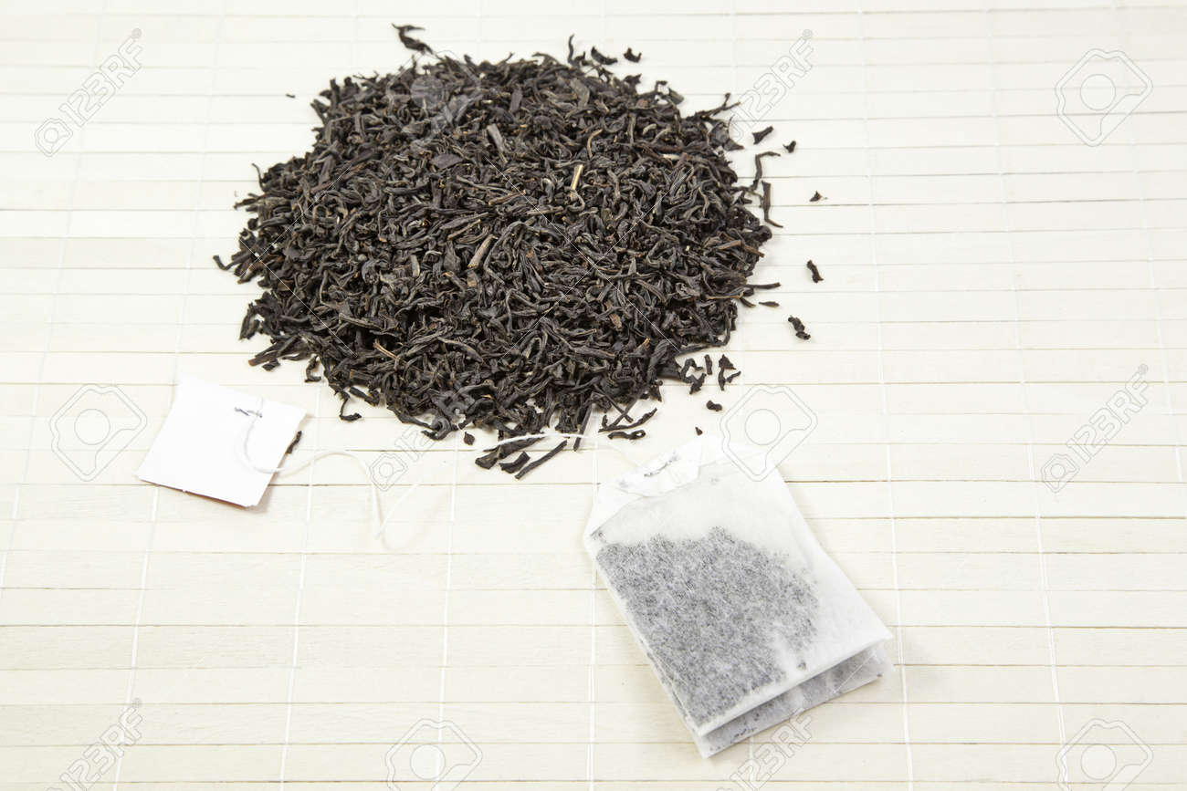 Leaves and black tea bag, detail of Japanese tea and infusion bags, oriental tea beverage Stock Photo - 18827737