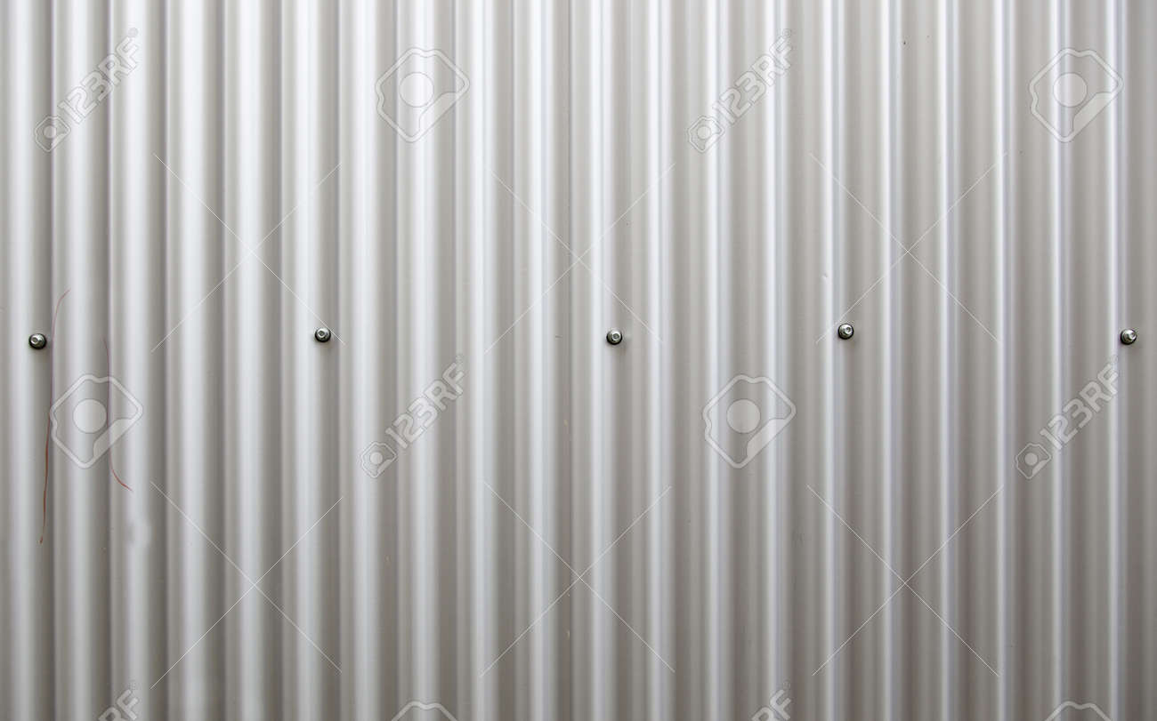 Corrugated metal wall, detail of a wall lined with metal, shiny steel Stock Photo - 19983301