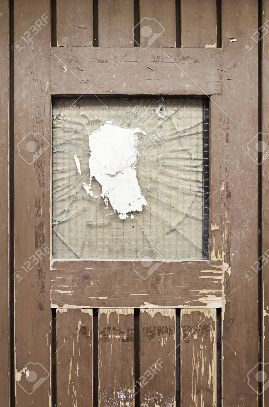 Old Broken Door, Detail Of A Door With A Broken Glass, And Drop Protection