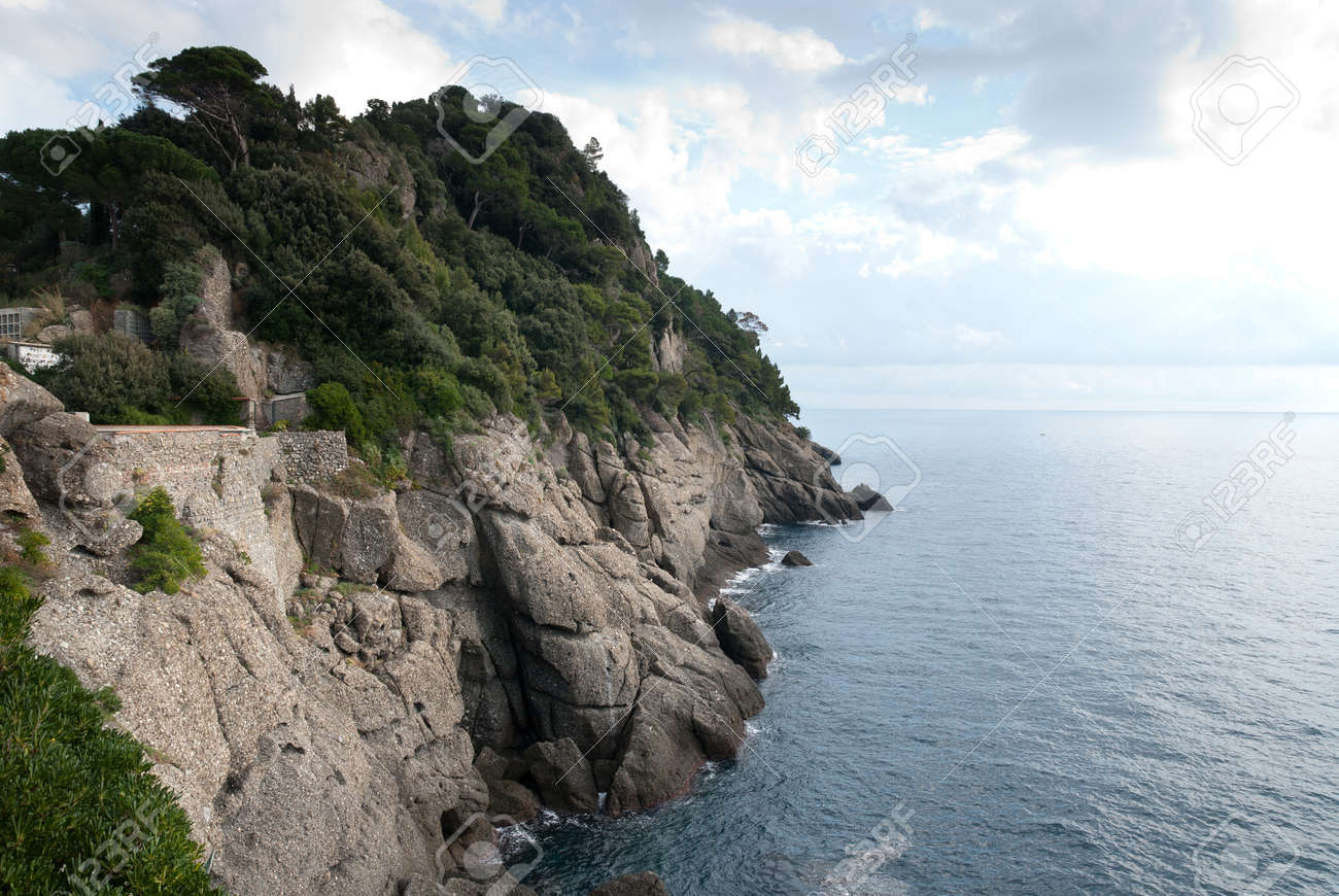 rocky cliff overlooking the sea in Portofino in Italy - 11727983