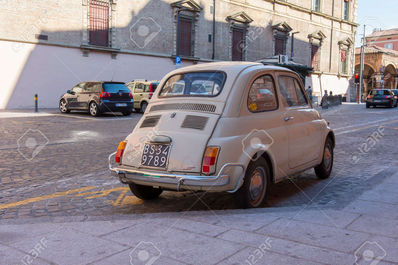 An Old Fiat 500 Car In The Street