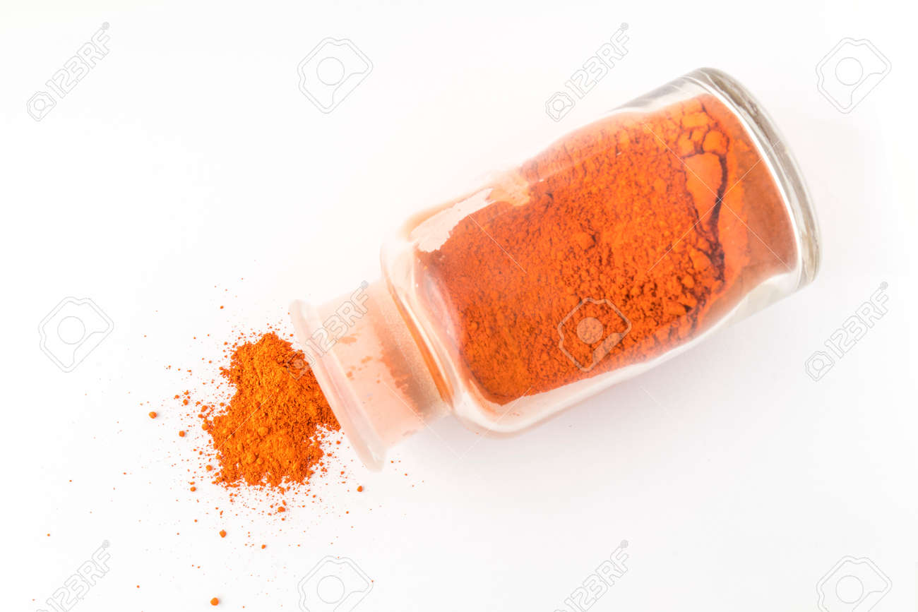 glass flask containing natural orange colored pigment powder stock