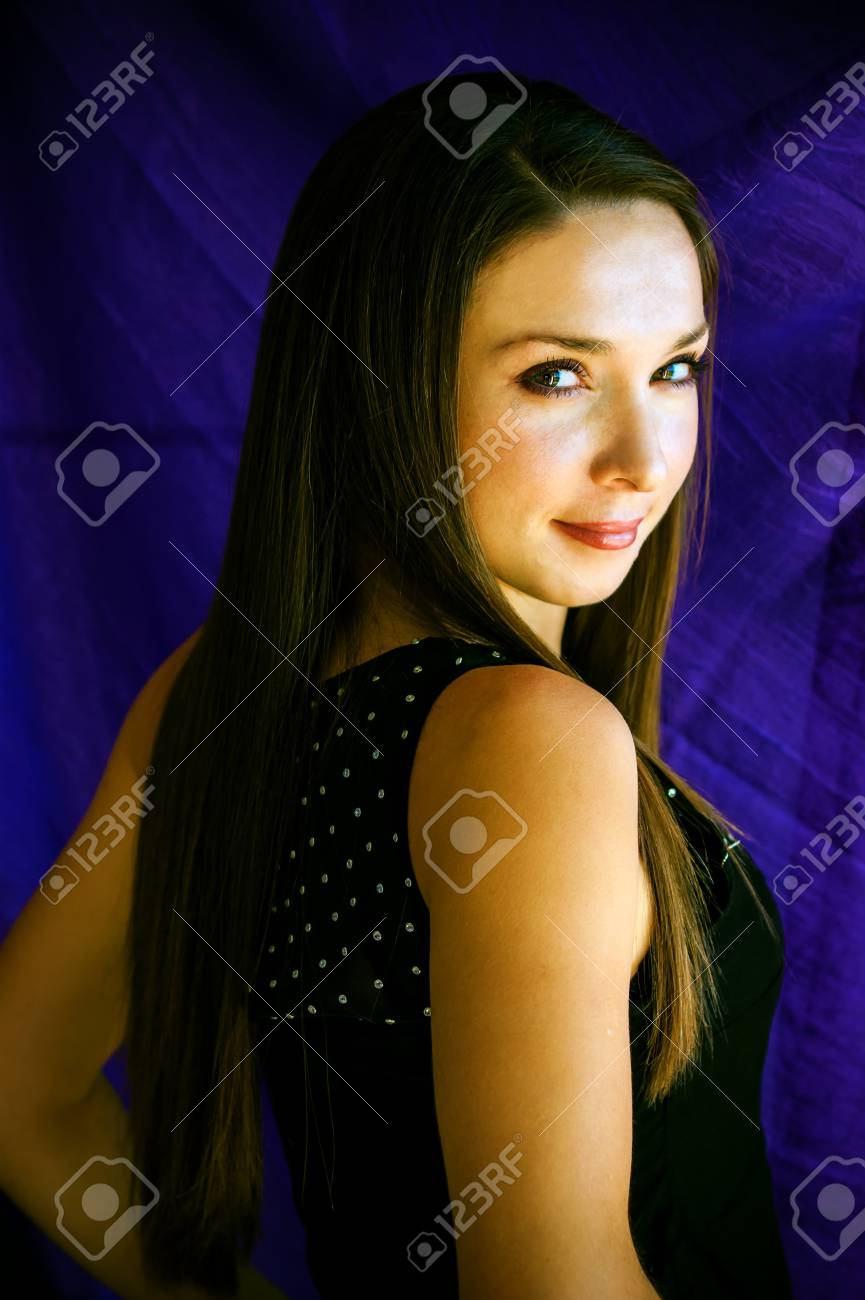 simply beautiful girl is photographed on a violet background Stock Photo - 17374476