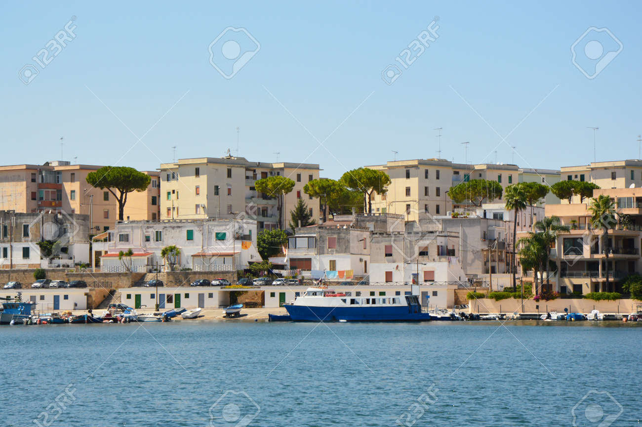 Blue water of Brindisi port with ships, Apulia, Italy - 84489600