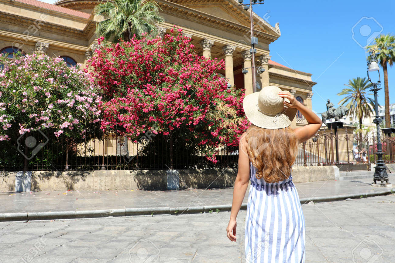 Travel in Sicily. Back view of beautiful woman visiting Palermo, Italy. - 169623244