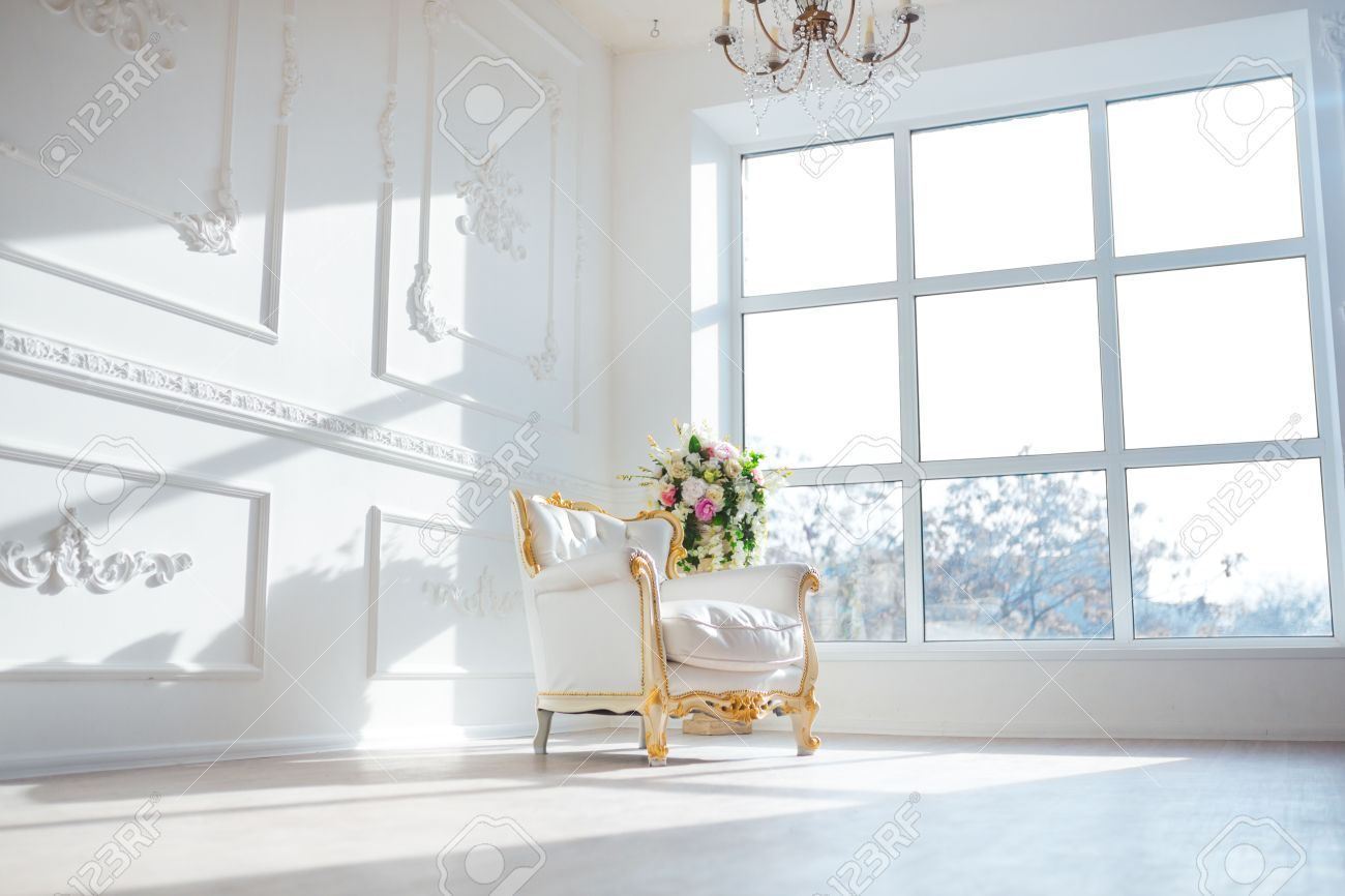 White leather vintage style chair in classical interior room with big window and spring flowers. - 52354934