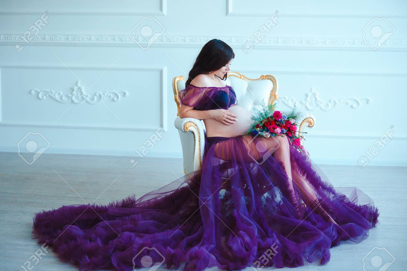 Beautiful Pregnant Woman In Violet Tender Dress At Luxury Classic Stock Photo Picture And Royalty Free Image Image 65105270