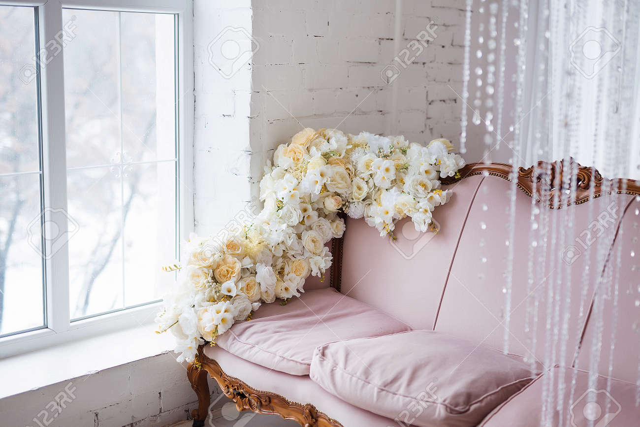 Vintage Style Sofa Decorated With Flowers In Loft Interior Room
