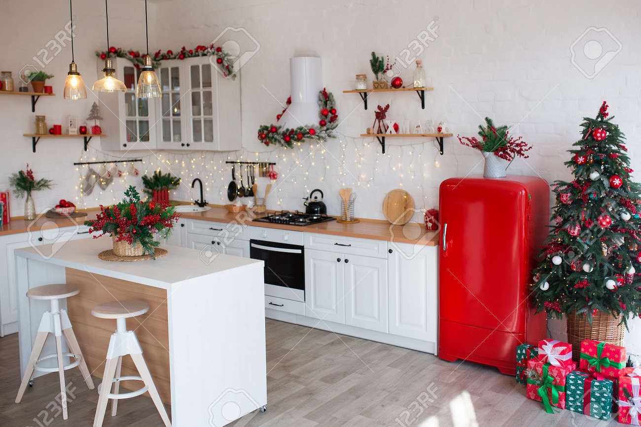 Modern Kitchen Interior with Island, Sink, Cabinets in New Luxury Home Decorated in Christmas Style. - 133879946