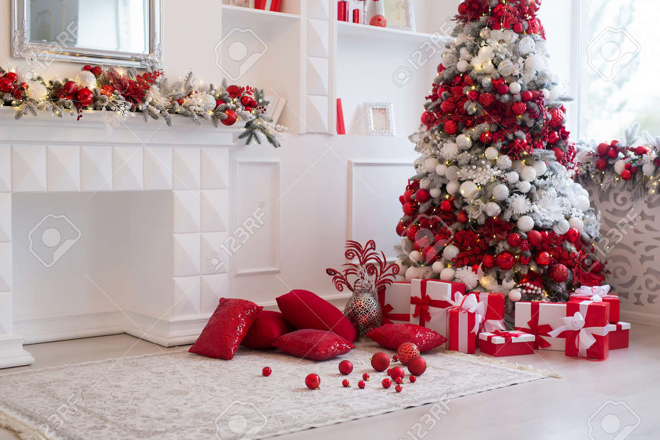 Interior of bright modern living room with fireplace decorated with Christmas tree and gifts - 158639718