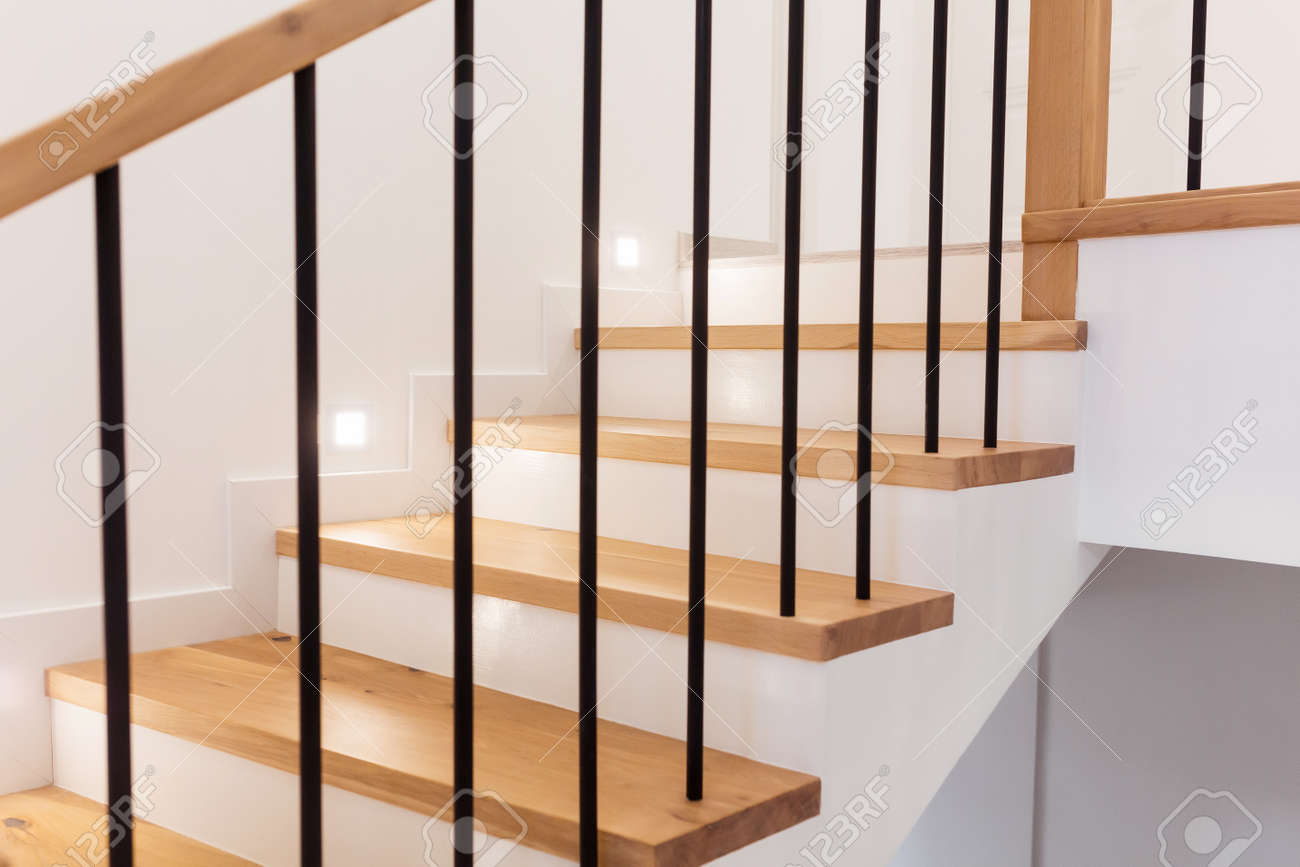 Wood staircase inside contemporary white modern house. - 165106452