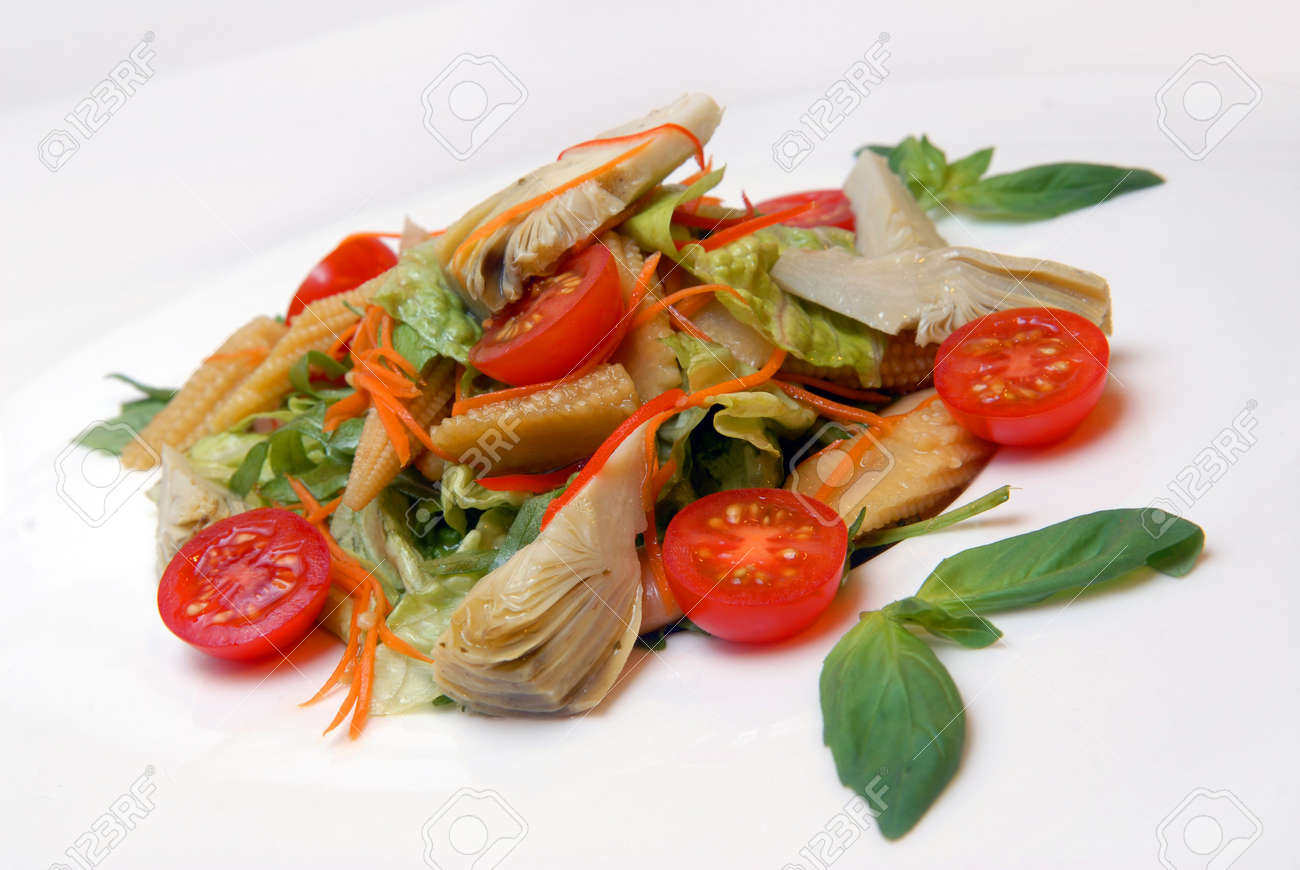 Salad from artichokes, ears of corn and tomatoes Stock Photo - 5359763