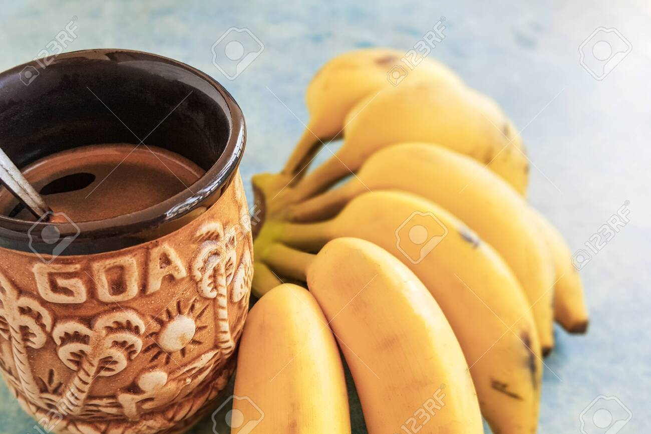 Ceramic Goa Coffee Mug And Bunch Of Yellow Bananas On A Blue Stock Photo Picture And Royalty Free Image Image 132071533