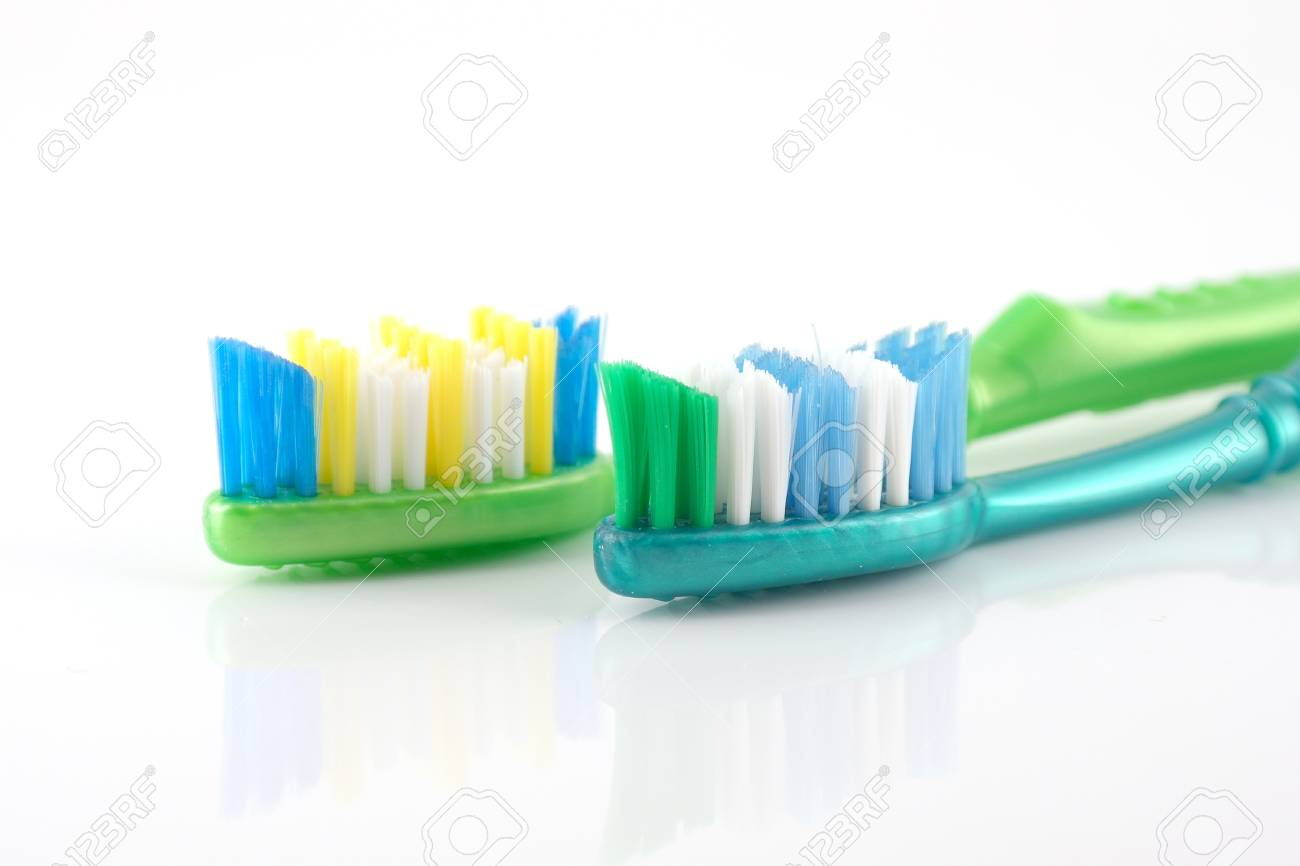 Two tooth-brushes over white Stock Photo - 14113501