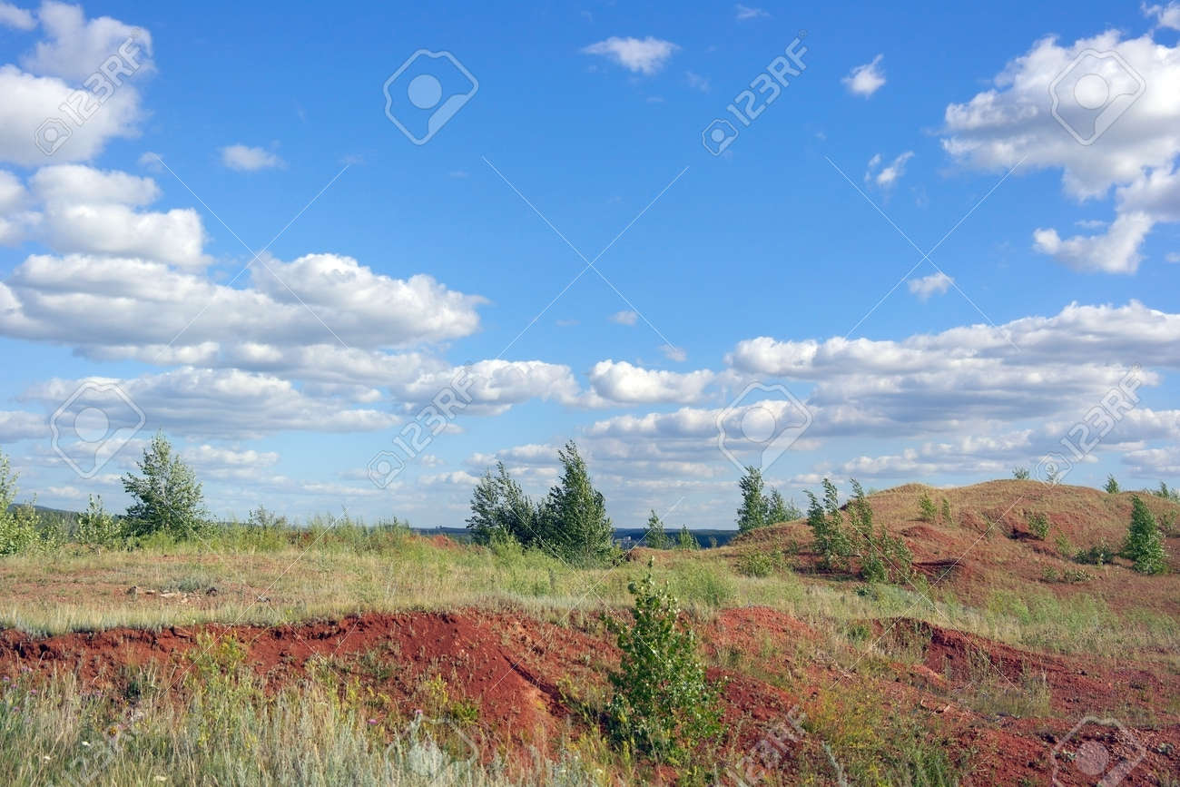 Beautiful summer landscape with trees on the hills from clay soil Stock Photo - 30180166