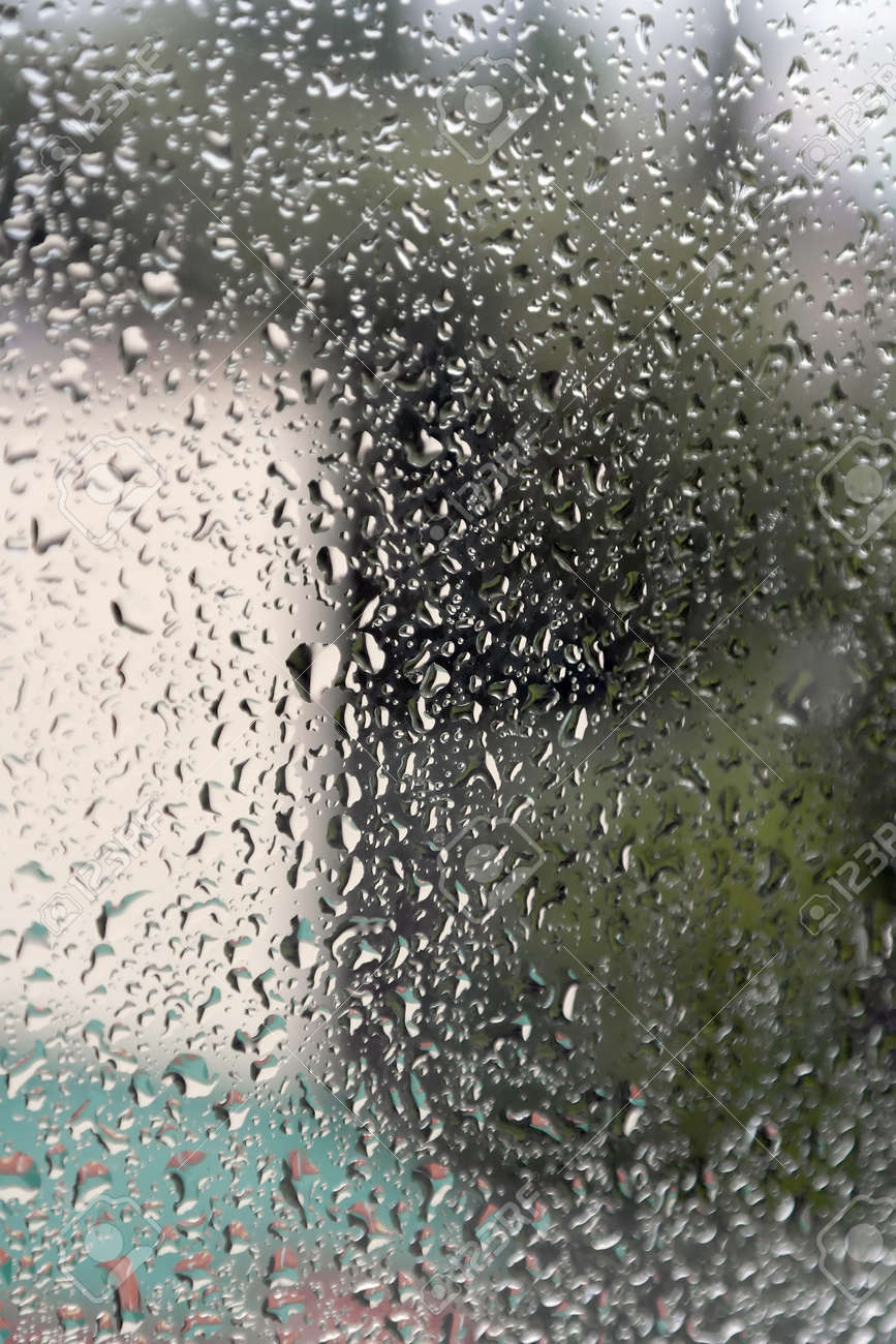 On a summer raining day. Drops of water on the window. Shallow DOF Stock Photo - 33198408