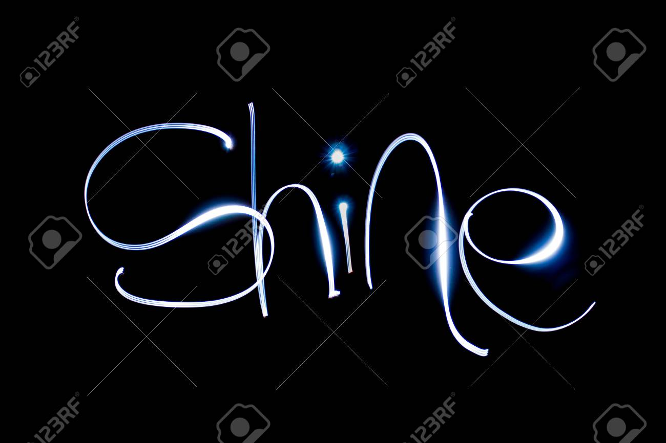 Light painting the word Shine. Stock Photo - 90738636