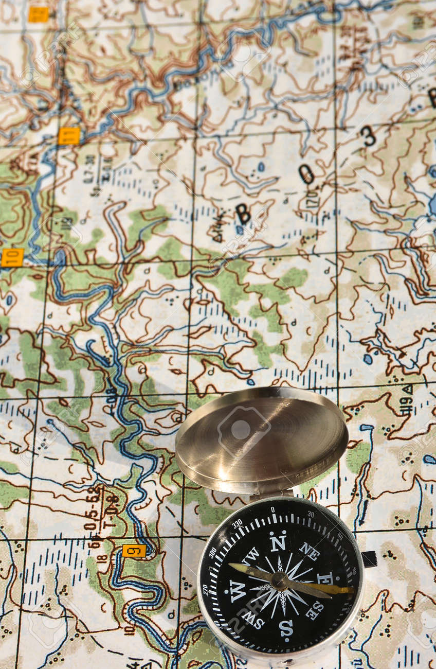 Topographic Map Games.Map And Compass Photo Magnetic Compass Located On A Topographic