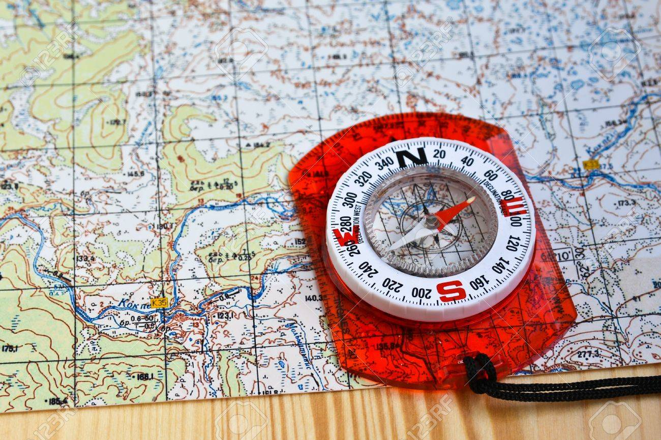 Map And Compass Orienteering Using A Map And Compass. Magnetic Compass On A